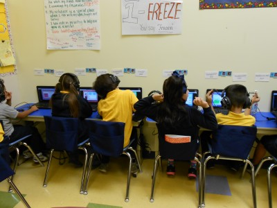 Third-grade students at Aspire Titan Academy work independently online for about 90 minutes a day. (Photo: Margaret Ramirez)